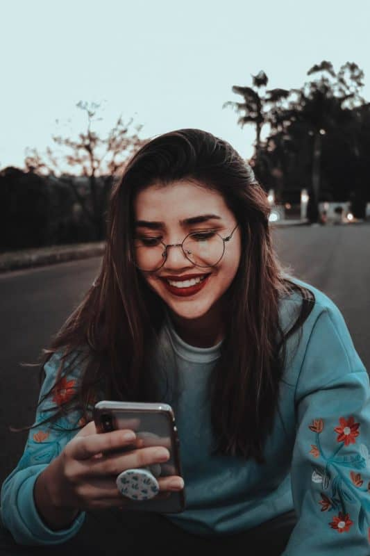 Girl Smiling at phone