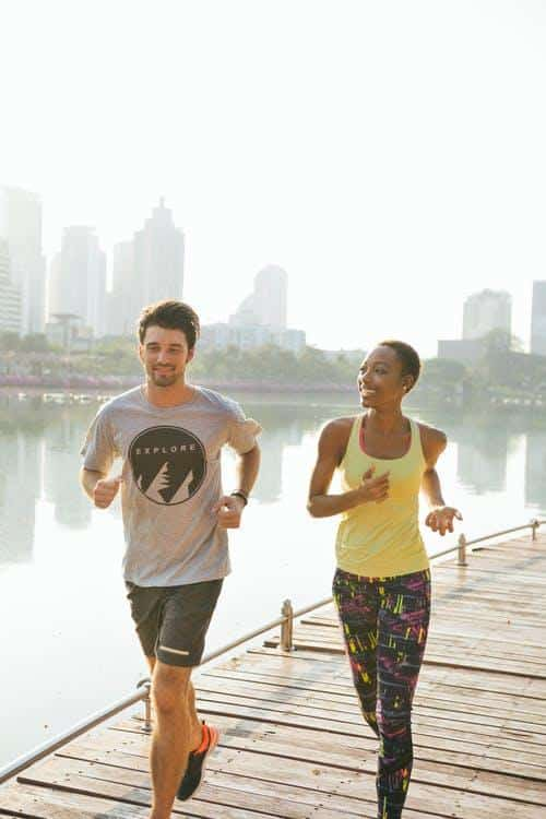 Man & Women Jogging Near Lake