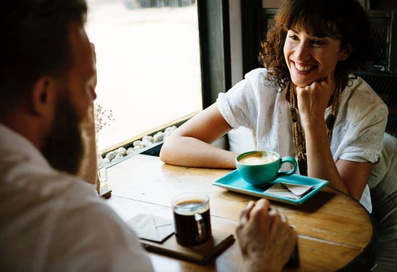 Smiling Woman on a Coffee Date