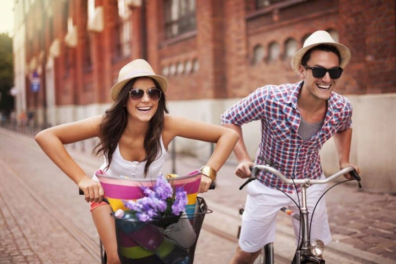 Young Couple Rides Bikes