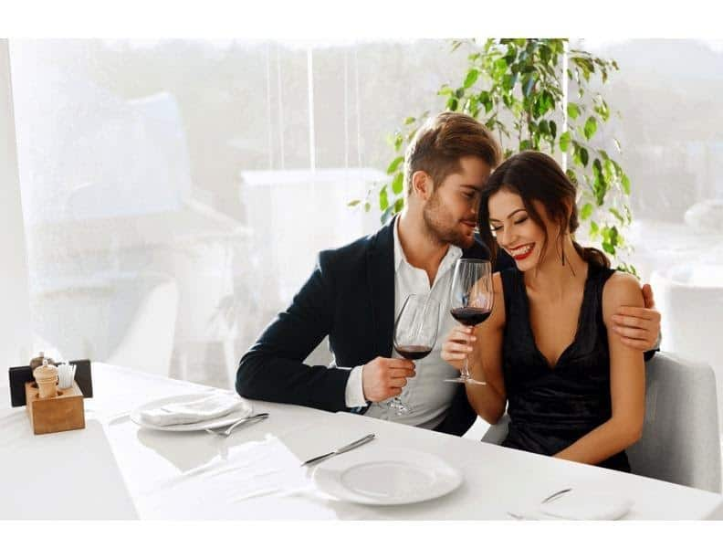 Man and women at a fancy dinner date